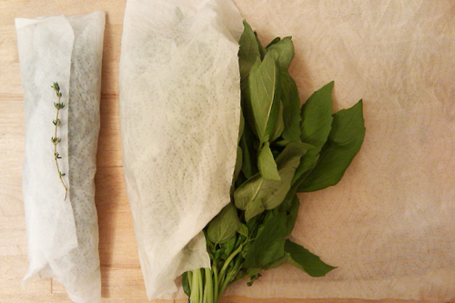 Storing herbs thyme and basil in damp towel